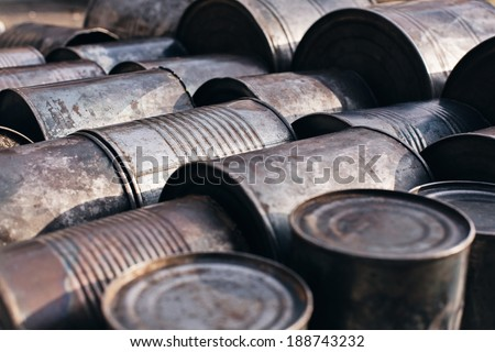old metal cans lying on the ground - stock photo