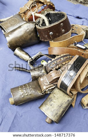 Old metal cowbells, detail of some ancient tools to animal sound - stock photo