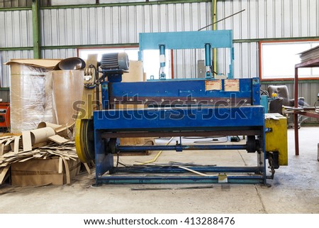 Old metal cutting machine in factory - stock photo