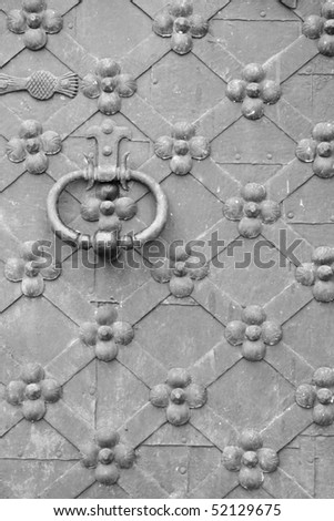 Old metal door with a door knocker background - stock photo