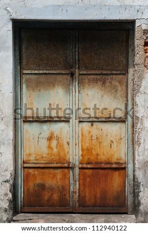 Old metal door with rust in Asia - stock photo