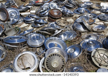 old metal hubcaps strewn across the ground