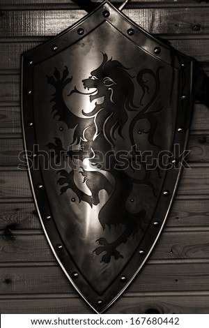 Old metal medieval shield - stock photo