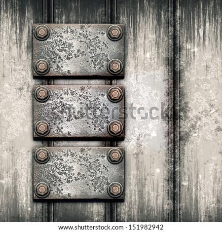 Old metal plate on metallic wall - stock photo