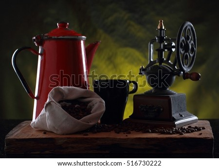 Old metal red coffee jug with retro coffee beans grinder
