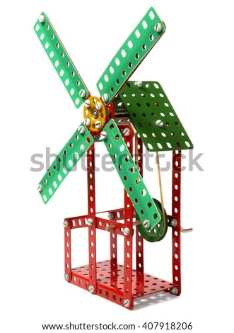 Old metal toy windmill isolated on white background - stock photo