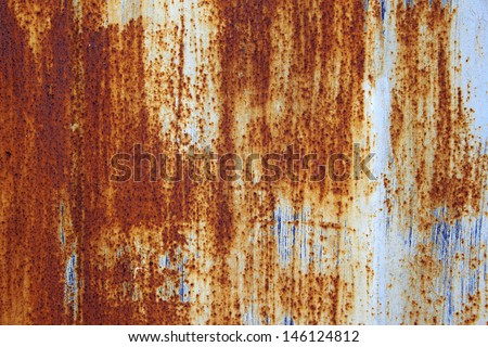 old metal wall background with rust - stock photo