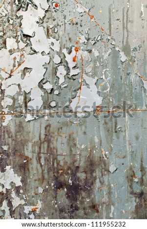 Old metal wall with paint peeling off - stock photo