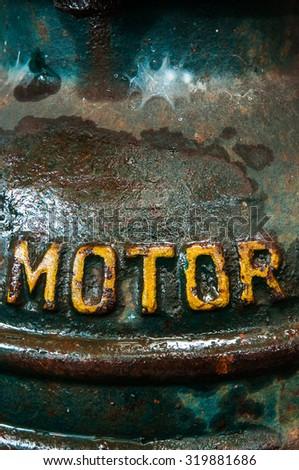 Old metal word motor. - stock photo