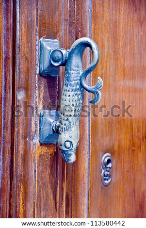 old metallic fish door knocker - stock photo