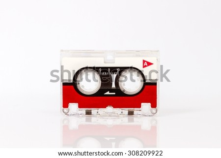 Old micro audio cassette isolated on white background and reflection