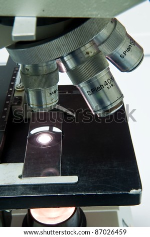 Old microscope in the laboratory. - stock photo