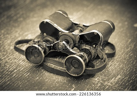 Old military binoculars vintage, retro style. Black - white photo - stock photo