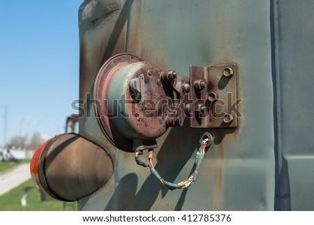 old military car headlight reflector closed, rusty grid - stock photo