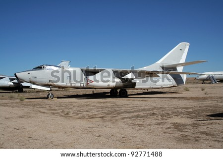 Old military plane in an aircraft graveyard in the desert