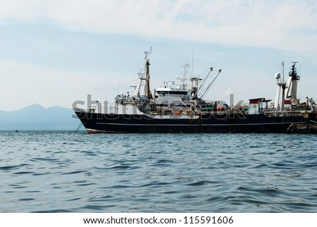old military ship in the bay on Kamchatka - stock photo