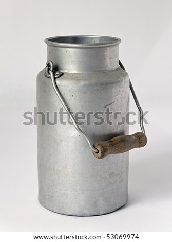 old milk can studio shot - stock photo
