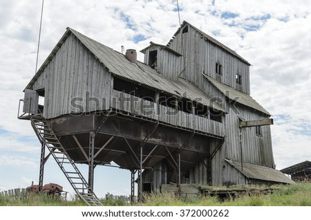 Old mill building in summer - stock photo