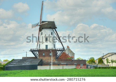 Old mill in the countryside of Belgium - stock photo