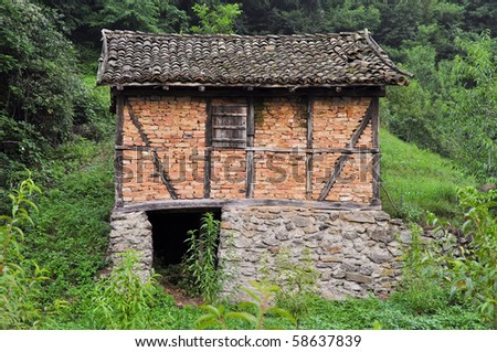 old mill in the woods - stock photo