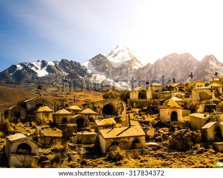 Old Milluni Miner's Cemetery near La Paz and Huyana Potosi mountain on background, Bolivia - stock photo