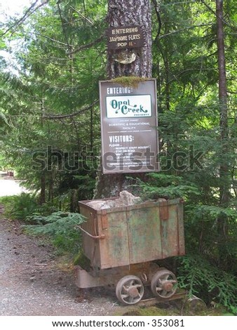 Old mining relics mark the entrance to Opal Creek in Oregon's Willamette National Forest. - stock photo