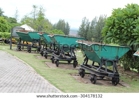 Old mining train in the park. - stock photo