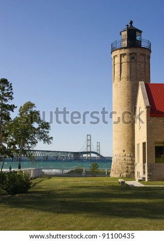 Old Mission Lighthouse and Mackinac Bridge -- Mackinaw City, Michigan, USA - stock photo