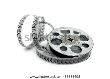 Old 16mm black and white film and reel - stock photo