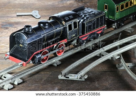 old model railway on wooden background