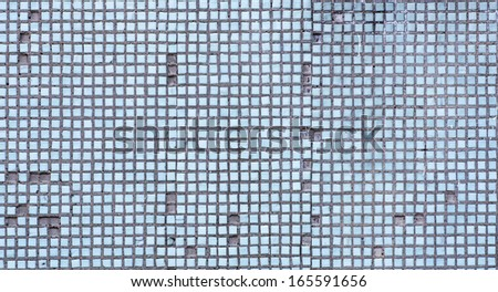 Old mosaic tile on wall, background. - stock photo