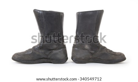 Old motorcycle boots, isolated on a white background