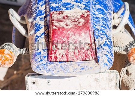 old motorcycle with dirty tail light box and right-sign light box - stock photo