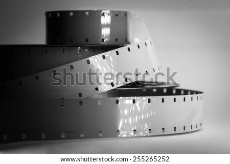 Old movie camera film reel strip - stock photo