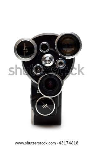 Old movie camera 16 mm with three lenses on white background - stock photo