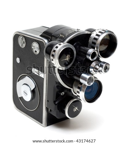 Old movie camera 16 mm with three lenses on white background