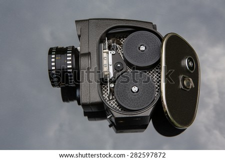 Old movie camera with open lavished channel - stock photo