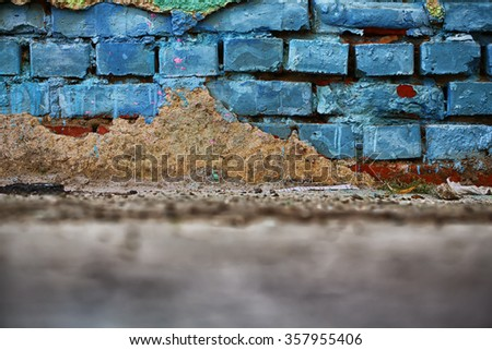 Old muddy grimy brick wall surface backdrop with gray stain colored by blue paint with blotshiness and cement stain neglect decoration wallpaper unkempt background copyspace closeup, horizontal  - stock photo