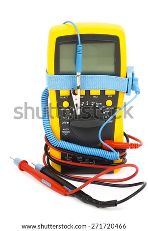 Old multimeter on a white background. Isolated image.Measurements in electrical instruments. - stock photo