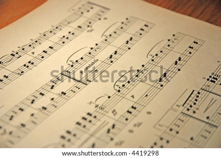 old music notes on the table - stock photo