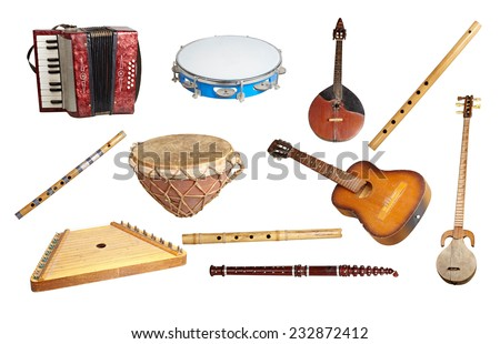 Old musical instruments from around the world, isolated on white background. - stock photo
