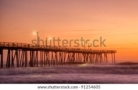 Old Nags Head, NC fishing pier at dawn - stock photo