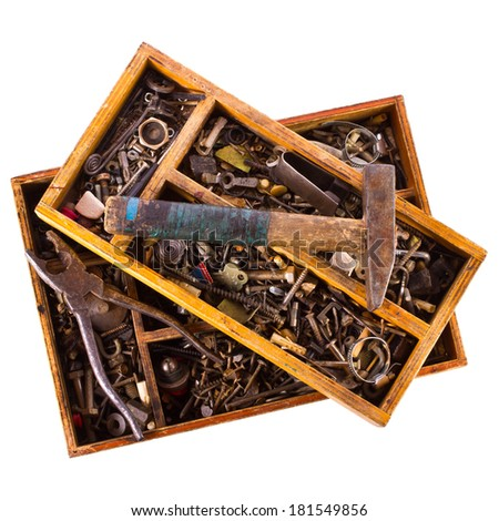 Old nails, screws and plugs in different types and sizes. Tools - stock photo