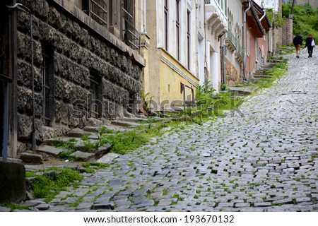 Old narrow alley in Budapest - stock photo