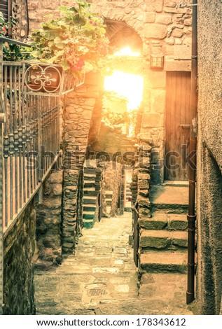 Old narrow alley in Giglio Castello - Antique italian lane in Giglio Island Tuscany Italy - stock photo