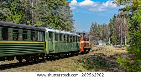Old narrow-gauge railway. Passenger train with diesel locomotive. Latvia. - stock photo