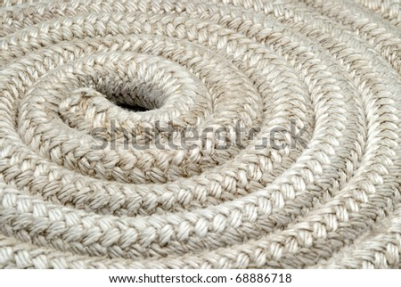 Old nautical rope - Closeup Detail on a reel of twisted boat's rope - stock photo