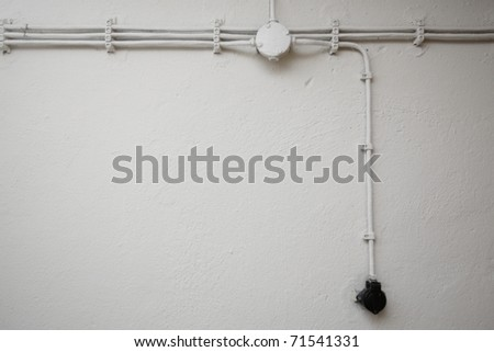 Old network electrical cables on the wall. - stock photo