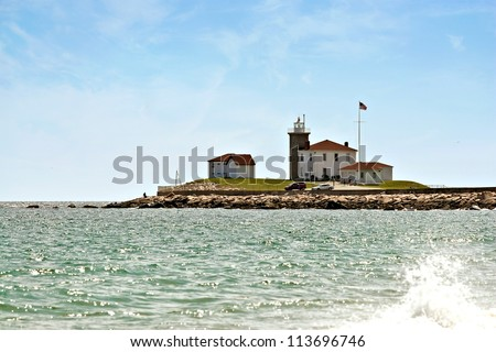 Old New England light house by the sea in Watch Hill Rhode Island. - stock photo