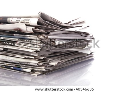 Old newspapers and magazines on a pile - stock photo